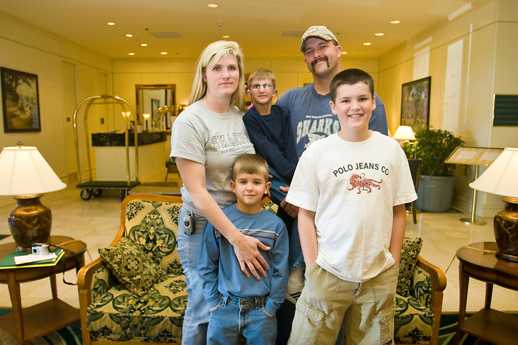 The Marietti family at the Share and Care Network's annual retreat held at the Doubletree Guest Suites Hotel in Boston on May 20, 2006. <br /> <br /> The Share and Care Network was created in 1981 by Pat Cahill when her son Scott was diagnosed with Cockayne Syndrome.  A rare form of dwarfism, Cockayne Syndrome is a genetically determined condition whose symptoms include microcephaly, mental retardation, progressive blindness, progressive hearing loss, premature aging, and a shortened lifespan averaging 18 years.  Those afflicted have distinctive facial features, including sunken eyes, pinched faces, and protruding jaws as well as distinctive gregarious, affectionate personalities.<br /> <br /> Because of the rarity of the condition (1/1,000 live births) and its late onset (characteristics usually begin to appear only after one year), many families and physicians are often baffled by children whose health begins to deteriorate after normal development.  It was partly with this in mind that the Share and Care Network was formed, to promote awareness of this disease as well as to provide a support network for those families affected.  In 1998 it began organizing an annual retreat, which has grown from three families in its inaugural year to more than 30 today.  Although the retreat takes place in the United States, families from as far as Japan arrive for this one weekend out of the year to share information and to support one another.