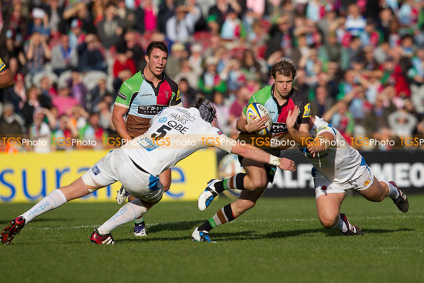 Nick Evans (Harlequins) is stopped by James Hanks (Exeter Chiefs) - Harlequins RFC vs Exeter Chiefs RFC - Aviva Premiership Rugby at Twickenham Stoop - 29/10/11 - MANDATORY CREDIT: Ray Lawrence/TGSPHOTO - Self billing applies where appropriate - 0845 094 6026 - contact@tgsphoto.co.uk - NO UNPAID USE.