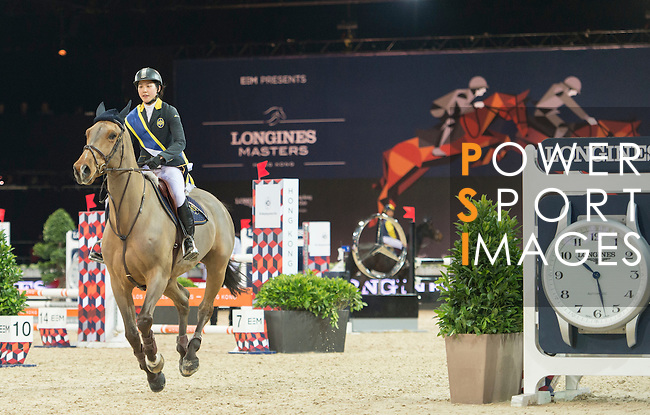 Jacqueline Lai during jump over the HKJC fence the HKJC Race of the Rider during the Longines Masters of Hong Kong on 19 February 2016 at the Asia World Expo in Hong Kong, China. Photo by Li Man Yuen / Power Sport Images