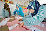 Teacher Ayda el-Habbash (center) teaches an advanced dressmaking class in the Vocational Training Center in Gaza City, Gaza. The center is sponsored by the Department of Service for Palestinian Refugees of the Near East Council of Churches, and funded in part by the Pontifical Mission for Palestine. DSPR is a member of the ACT Alliance.
