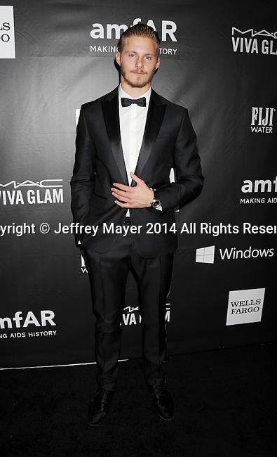HOLLYWOOD, CA- OCTOBER 29: Actor Alexander Ludwig attends amfAR LA Inspiration Gala honoring Tom Ford at Milk Studios on October 29, 2014 in Hollywood, California.
