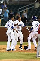 Chattanooga Lookouts first baseman O'Koyea Dickson (7) congratulated by Casio Grider (5) and Darnell Sweeney (9) after a walk off base hit during a game against the Birmingham Barons on April 24, 2014 at AT&T Field in Chattanooga, Tennessee.  Chattanooga defeated Birmingham 5-4.  (Mike Janes/Four Seam Images)