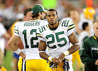Aug. 28, 2009; Glendale, AZ, USA; Green Bay Packers running back (25) Ryan Grant and quarterback (12) Aaron Rodgers against the Arizona Cardinals during a preseason game at University of Phoenix Stadium. Mandatory Credit: Mark J. Rebilas-