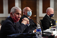 Dr. Anthony Fauci, director of the National Institute for Allergy and Infectious Diseases, wears a face mask while testifying before the Senate Health, Education, Labor and Pensions (HELP) Committee on Capitol Hill in Washington DC on Tuesday, June 30, 2020.  Fauci and other government health officials updated the Senate on how to safely get back to school and the workplace during the COVID-19 pandemic. <br /> Credit: Kevin Dietsch / Pool via CNP /MediaPunch