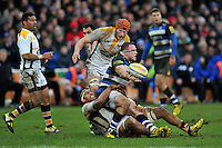 Henry Thomas of Bath Rugby offloads the ball after being tackled to ground. Aviva Premiership match, between Bath Rugby and Wasps on February 20, 2016 at the Recreation Ground in Bath, England. Photo by: Patrick Khachfe / Onside Images