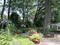 Allan McKeown<br /> 1446 Sylvan Court<br /> Amckeown1@cogeco.ca<br /> <br /> Split Personality Garden!<br /> Hot and sunny in front &ndash; cool oasis at back.<br /> <br /> Back garden is a cool oasis under a canopy of mature oaks, creating a pleasing view from the patio:<br /> Mostly perennials and native plants<br /> 8 types of hydrangea and sedum, hostas, campanulas, rubeckia, coreopsis<br /> Trees; oaks, cedars, red bud<br /> The bubbling rock feature attracts many birds and provides an endless source of entertainment!<br /> <br /> Front: bright white flowered oak hydrangeas, hostas, hardy geranium, coral bells, brunnera, sedum, Japanese fountain grass, some Native plants and mix of shrubs<br /> Trees; oaks, magnolia, Saskatoon berry, Japanese maple, cedars.<br /> <br /> The abundance of oak trees in the neighbourhood create a feeling of living in a small forest, the garden being a &ldquo;forest floor&rdquo; of diversity and colour!