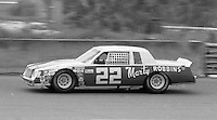 Country singer Marty Robbins races down the back stretch in his #22 Buick Regal during the Firecracker 400 Daytona International Speedway Daytona Beach FL July 1982.(Photo by Brian Cleary/www.bcpix.com)(Photo by Brian Cleary/www.bcpix.com)