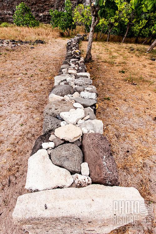 Restored ancient Hawaiian stone wall in  Nualolo Kai village, Na Pali Coast, Kaua'i