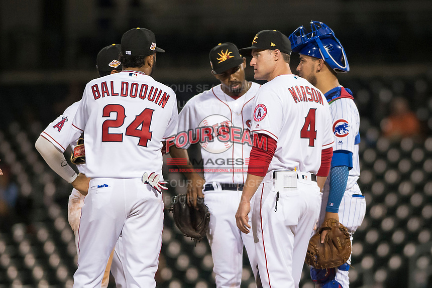 Mesa Solar Sox manager Lou Marson (4), of the Los Angeles Angels organization, meets with Roberto Baldoquin (24), Josh Ockimey (28), and Jhonny Pereda (6) during a pitching change in an Arizona Fall League game against the Scottsdale Scorpions at Sloan Park on October 10, 2018 in Mesa, Arizona. Scottsdale defeated Mesa 10-3. (Zachary Lucy/Four Seam Images)