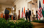 Washington, DC - November 24, 2009 -- United States President Barack Obama, right, and Manmohan Singh, India's prime minister, arrive to a ceremony in the East Room of the White House in Washington, D.C., U.S., on Tuesday, November 24, 2009. Singh was welcomed to the White House this morning by Obama for a state visit where the two leaders will have discussions on curbing nuclear weapons, climate change and trade. .Credit: Andrew Harrer - Pool via CNP