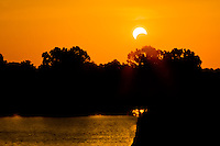 Eclipse at sunset  on the Arkansas River in eastern Oklahoma May 20, 2012.