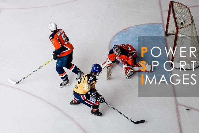 Ryo Miyazaki of Empire Skate (C) battle in the goal mouth with Singapore Hawkers Goalie George Chow (R) during the Mega Ice Hockey 5s match between Singapore Hawkers and Empire Skate on May 04, 2018 in Hong Kong, Hong Kong. Photo by Marcio Rodrigo Machado / Power Sport Images