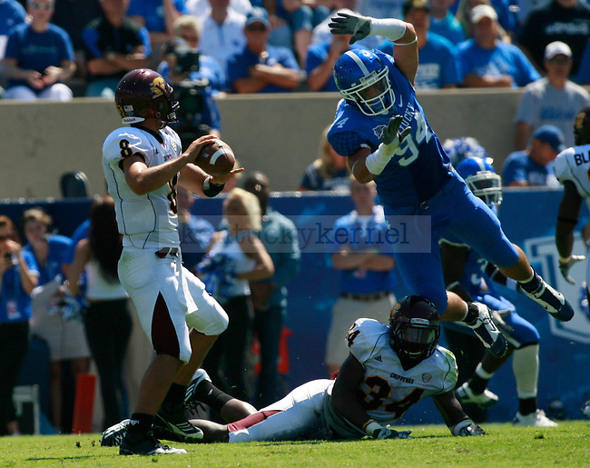 Central Michigan quarterback Ryan Radcliff looks to pass with heavy coverage during the first half of UK's first home game against Central Michigan, Saturday, Sept. 10, 2011 in Lexington, Ky.  Photo by Brandon Goodwin | Staff