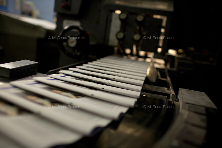 Printed papers come off the press at Moskovskii Komsomolets in Moscow, Russia.