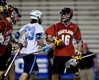 Dean Hart (16) of Maryland celebrates a goal with his teammates during the ACC men's lacrosse tournament semifinals in College Park, MD.  Maryland defeated North Carolina, 13-5.