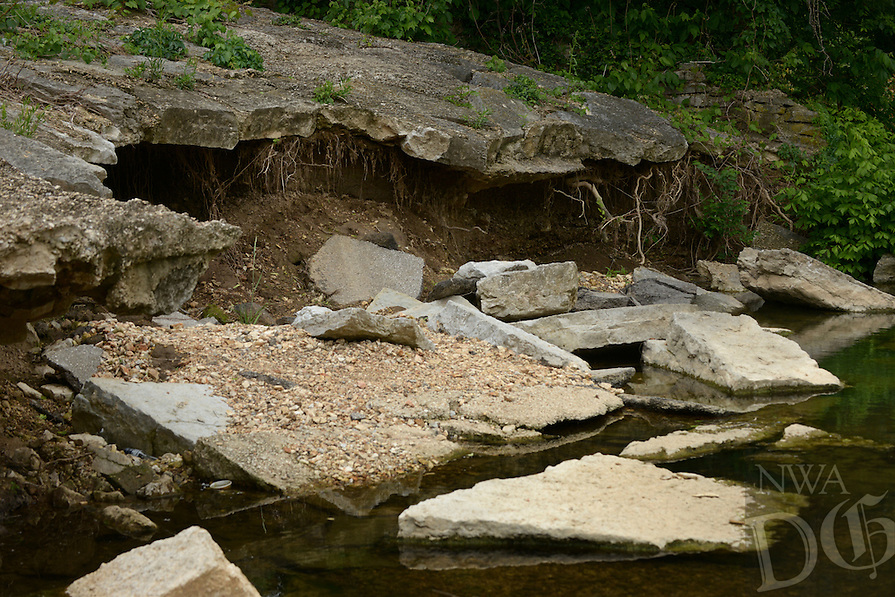 NWA Democrat-Gazette/BEN GOFF @NWABENGOFF<br /> A view of broken concrete and erosion on the back side of the dam on Thursday May 19, 2016 at Lake Bella Vista in Bentonville.