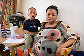 Fauzi Salifu and her son Sadiq in the one bedroom flat she shares with her husband and two children  in Alexandra Court, a hostel used by Hackney Council as temporary accommodation for homeless families.