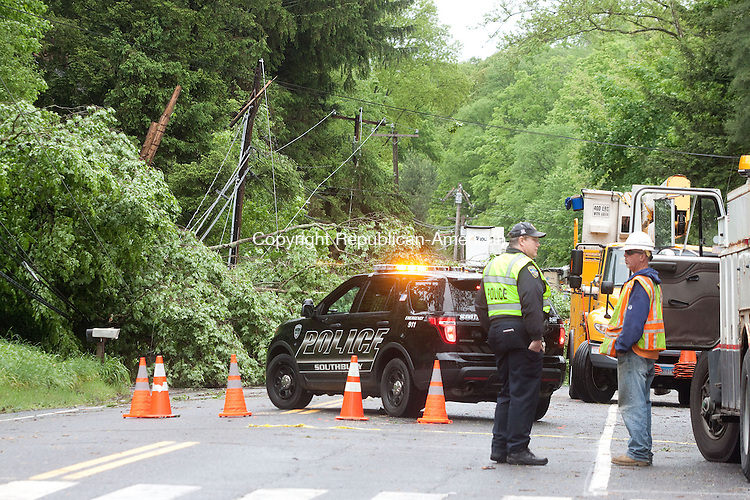 SOUTHBURY CT- MAY 14 2014 052814DA08-  Vehicles had to be diverted from Rt. 172 to Flood Bridge Road in Southbury Wednesday morning after a tree fell across both lanes bringing power lines down during Tuesday evenings storm.<br /> Darlene Douty Republican American