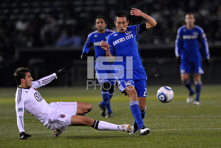 Davy Arnaud (blue) evades the challenge of Dejan Jakovic...Kansas City Wizards defeated D.C Utd 4-0 in their home opener at Community America Ballpark, Kansas City, Kansas.