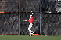 GREENSBORO, NC - FEBRUARY 25: Dan Ryan #10 of Fairfield University catches a fly ball on the warning track during a game between Fairfield and UNC Greensboro at UNCG Baseball Stadium on February 25, 2020 in Greensboro, North Carolina.