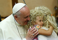 "Papa Francesco saluta una bambina urante l'udienza i partecipanti all'Incontro Mondiale dei Dirigenti di Scholas Occurentes, nell'Aula del Sinodo, Citta' del Vaticano, 4 settembre 2014.<br /> Pope Francis greets a child during his audience to participants in the ""Scholas Occurentes"" executives world meeting, at the Vatican, 4 September 2014.<br /> UPDATE IMAGES PRESS/Riccardo De Luca<br /> <br /> STRICTLY ONLY FOR EDITORIAL USE"