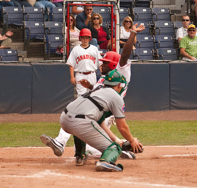 Tuesday, July 14, 2009.  Vancouver Canadians Rasun Dixon slides in to home base avoiding the tag from Boise Hawks catcher Matt Williams.  The 6th inning run made the score 3-2 for the Canadians, and was the final score in the game.  Photo by Gus Curtis.