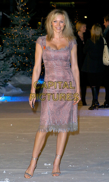 "NELL McANDREW .At the UK Film Premiere of ""The Holiday"", Odeon Leicester Square, London, UK..December 5th 2006.full length purple silver lace dress strappy sandals shoes.CAP/CAN.©Can Nguyen/Capital Pictures"
