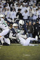 22 November 2008:  Penn State DE Aaron Maybin (59) tackles Michigan State RB Javon Ringer (23).  The Penn State Nittany Lions defeated the Michigan State Spartans 49-18 to win the Land Grant Trophy and 2008 Big Ten Conference Championship at Beaver Stadium in State College, PA..