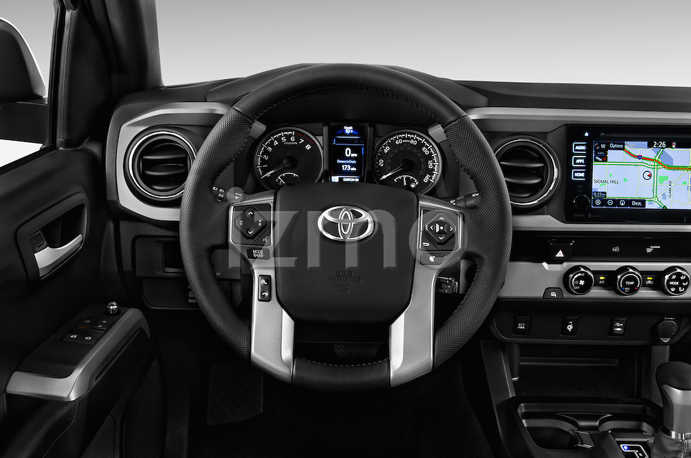 Car pictures of steering wheel view of a 2016 Toyota Tacoma TRD Sport 4 Door Pick Up Steering Wheel