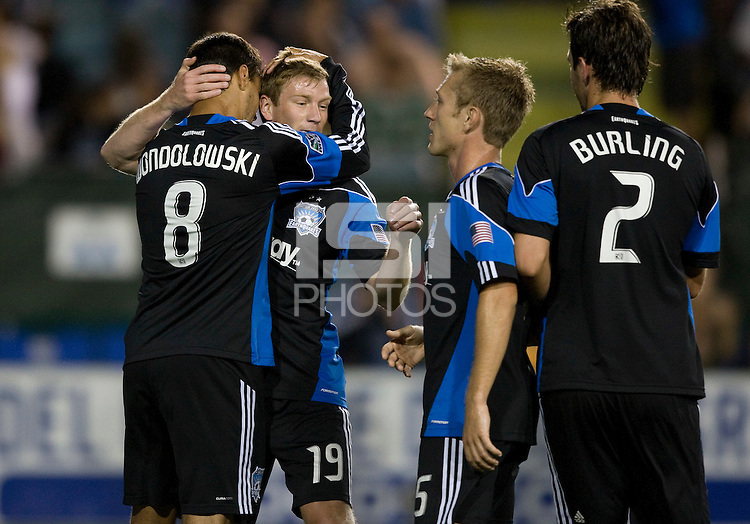 Chris Wondolowski of Earthquakes celebrates with Jacob Peterson of Earthquakes after Wondolowski scored a goal during the game against the WhiteCaps at Buck Shaw Stadium in Santa Clara, California on July 20th, 2011.  Earthquakes and WhiteCaps are tied 2-2 at the end of the game.