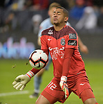 The ball ricochets off goalkeeper Jose Guerra of Independiente after a point-blank shot by Sporting KC. Sporting KC defeated Club Atletico Independiente 3-0 in a CONCACAF Champions League quarterfinal game at Children's Mercy Park on March 14, 2019.