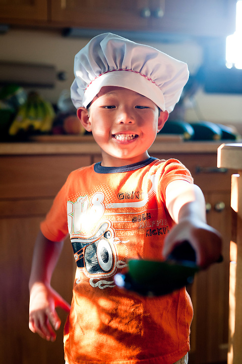 Chef Holden Miller, 5, serves up a tasty treat at the Miller/Stute home in Madison, Wis., on July 28, 2012.