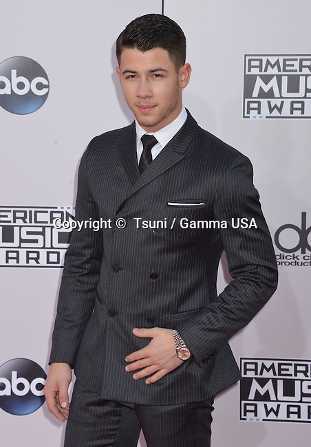 Nick Jonas 196 at the 2014 American Music Awards arrival at the Nokia Theatre on Nov. 23, 2014, in Los Angeles.