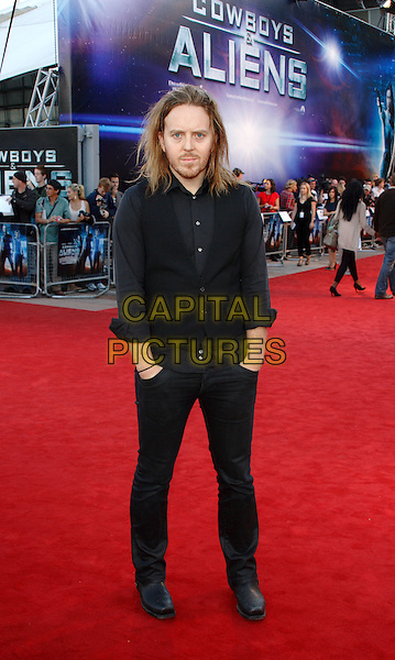 TIM MINCHIN.UK Premiere of 'Cowboys and Aliens' at the Cineworld cinema at the O2 Arena, London, England..August 11th 2011.half length waistcoat grey gray shirt stubble facial hair hands in pockets jeans denim.CAP/ROS.©Steve Ross/Capital Pictures