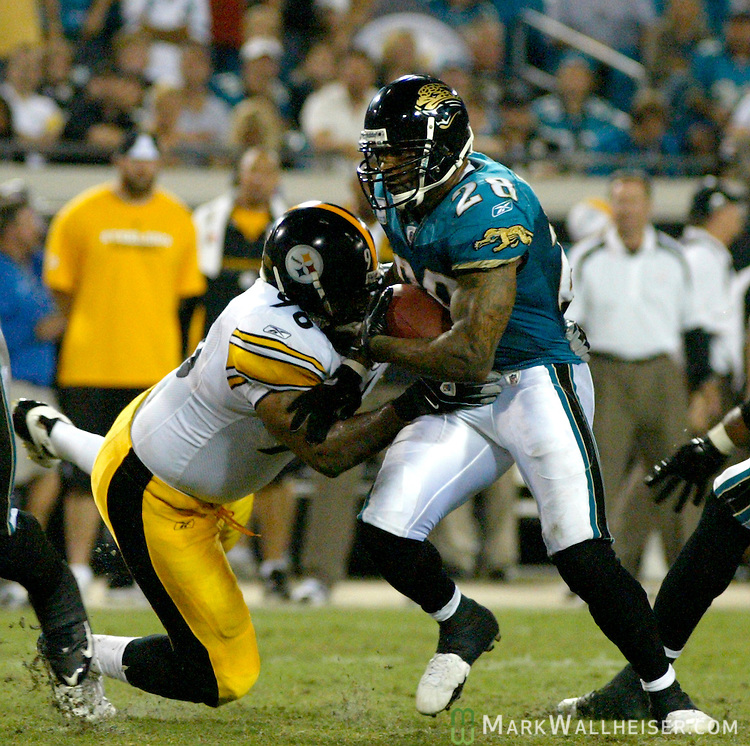 Jacksonville Jaguars running back Fred Taylor (28) brushes aside Steelers defensive end Orpheus Roye (96) during the Steelers 26-21 victory over the Jacksonville Jaguars in their NFL football game in Jacksonville, Florida October 5, 2008.  (Mark Wallheiser/TallahasseeStock.com)