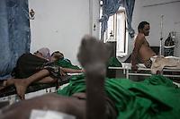 July 05, 2015 - Hajjah, Yemen: Civilians are seen inside an emergency ward at  Jamhoony hospital in Hajjah city after they arrived from Harad, a border town where a fighter jet of the Saudi-led coalition dropped a bomb over a market place killing 30 and leaving 67 severely wounded. (Photo/Narciso Contreras)