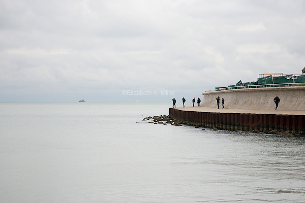 Tourists observe the view of Lake Michigan from Grant Park.