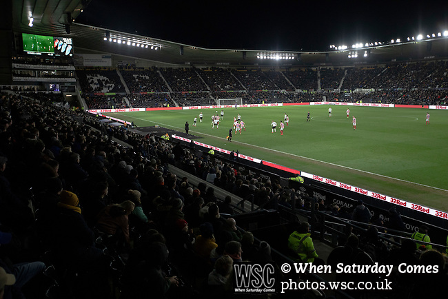 Home fans watching the second-half as Derby County (in white) played Stoke City in an EFL Championship match at Pride Park Stadium. Opened in 1997, it is the 16th-largest football ground in England and the 20th-largest stadium in the United Kingdom. The fixture ended in a 0-0 draw watched by a crowd of 25,685.