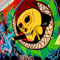 A skull graffiti artwork, illustrating the extensive Death worship culture in Mexico, appears on the wall in Morelia, Michoacán, Mexico, 3 November 2014.