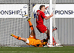 Raith keeper and defender Paul Watson combine to clear the ball from the line as Dumbarton attack late on