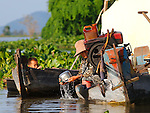 OLD WOMAN CLEANNING  IN CHONG KOS FLOATING VILLAGES AT TONLE SAP RIVER