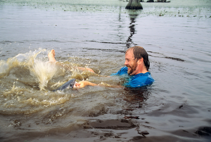 Blue Catfish<br /> Photos by Keith &quot;Catfish&quot; Sutton Man noodling or grabbling blue catfish in North Carolina lake