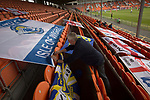 A visiting fan attaches a flag to seating during the first-half at Bloomfield Road stadium as Blackpool hosted Portsmouth in an English League One fixture. The match was proceeded by a protest by around 500 home fans against the club's controversial owners Owen Oyston, many of whom did not attend the game. The match was won by the visitors by 2-1 with two goals by Ronan Curtis watched by just 4,154 almost half of which were Portsmouth supporters.