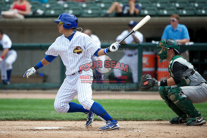 Peoria Chiefs Javier Baez #25 bats in front of catcher Kenny Swab #22 during a game against the Kane County Cougars at O'Brien Field on July 1, 2012 in Peoria, Illinois.  Kane County defeated Peoria 7-2.  (Mike Janes/Four Seam Images)