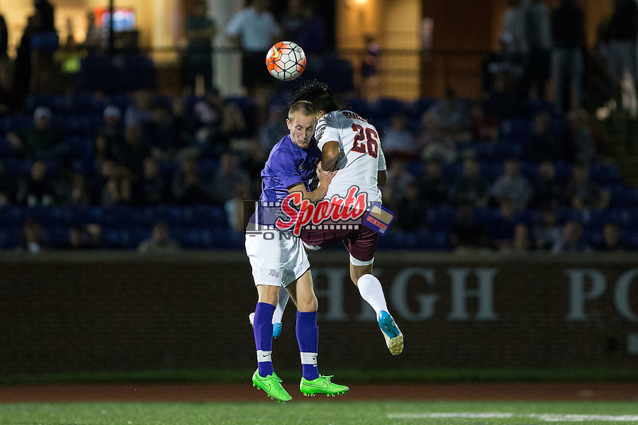 Justin Shear (7) of the High Point Panthers battles for a jump ball with Juan Pablo Saavedra (26) of the Virginia Tech Hokies during first half action at Vert Track, Soccer & Lacrosse Stadium on October 13, 2015 in High Point, North Carolina.  The Panthers defeated the Hokies 2-1 in overtime.  (Brian Westerholt/Sports On Film)