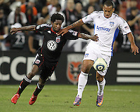 Clyde Simms #19 of D.C. United pushes Eduardo #23 of the San Jose Earthquakes during an MLS match at RFK Stadium in Washington D.C. on October 9 2010. San Jose won 2-0.