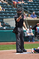 Home plate umpire Dan Merzel makes a strike call during the International League game between the Indianapolis Indians and the Columbus Clippers at Huntington Park on June 17, 2018 in Columbus, Ohio. The Indians defeated the Clippers 6-3.  (Brian Westerholt/Four Seam Images)
