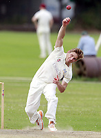 Ian Swallow bowls for Highgate during the Middlesex County Cricket League Division Three game between Highgate and North London at Park Road, Crouch End on Sat July 12, 2014