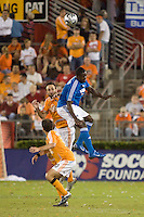 Kansas City Wizards forward Eddie Johnson (7) and Houston Dynamo defender Ryan Cochrane (5) go up for the ball. The Houston Dynamo defeated the Kansas City Wizards 2-0 at Robertson Stadium in Houston, TX on November 10, 2007 to capture the MLS Western Conference Championship. The Houston Dynamo will take on the New England Revolution in the MLS Cup Final on November 18, 2007 at RFK Stadium in Washington D.C.
