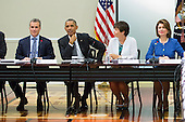From left, Jeffrey Zients, Director of the National Economic Council and Assistant to the President for Economic Policy, United States President Barack Obama,  advisor Valerie Jarrett, and Maria Contreras-Sweet, Administrator of the Small Business Administration, meet with company executives and their small business suppliers, in the Eisenhower Executive Office Building in Washington, D.C., July 11, 2014.  The President planned to announce the creation of 'SupplierPay,' a new partnership with the private sector aimed at strengthening small businesses by increasing their working capital. <br /> Credit: Drew Angerer / Pool via CNP